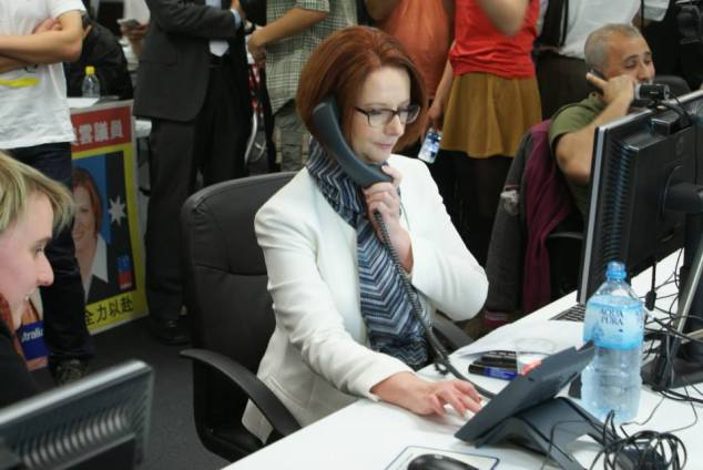Australian Prime Minister Julia GIllard makes calls alongside volunteers at a large phone bank in the Labor Party Campaign Headquarters in Parramatta, Australia